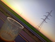 Kaffe och solnedgång royaltyfria foton
