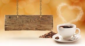 Kaffe och träbräde royaltyfri bild