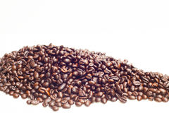 Kaffeböna i isolerat bakgrundsidébegrepp Royaltyfri Fotografi
