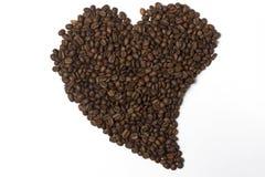 Kaffebönor fodrade i formen av hjärta Royaltyfri Foto