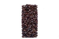 Kaffebönor i en form av en rektangel Arkivfoton