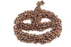 Kaffebönor i form av stålarnolla-lyktan på den vita bakgrunden Royaltyfri Fotografi