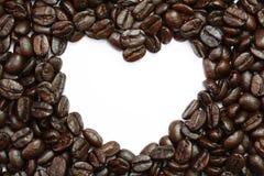 Kaffebönor i hjärtaform. Royaltyfria Bilder