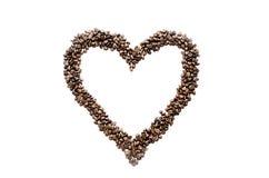 Kaffebönor och hjärta Arkivbild