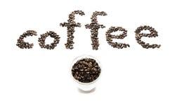 Kaffebönor och kuper Royaltyfri Foto