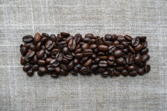 Kaffebönor på bakgrund arkivfoto