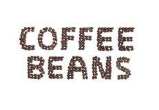 KAFFEBÖNOR som är skriftliga med kaffebönor Royaltyfria Bilder