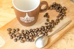 Kaffebönor som bryggar, grundar nytt Arkivbild