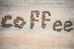 Kaffebönor som ordkaffe Fotografering för Bildbyråer
