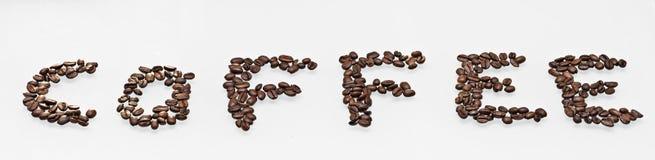 Kaffebönor som säger kaffe Arkivbilder