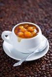 kaffedriftstopppersika Arkivfoto