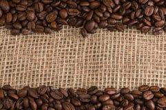 Kaffee auf Gewebehintergrund Stockfotografie