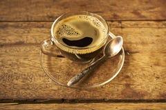 Kaffee auf hölzernem Lizenzfreie Stockfotos