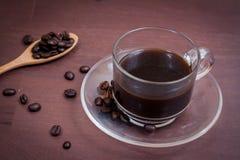 Kaffee auf hölzernem Hintergrund des Schmutzes Stockfotos