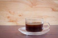 Kaffee auf hölzernem Hintergrund des Schmutzes Stockfotografie