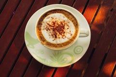 Kaffee auf Holz Lizenzfreies Stockbild