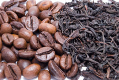 Kaffee gegen Tee Lizenzfreie Stockfotografie