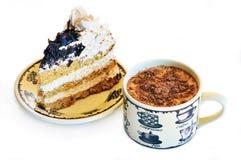 Kaffee mit einer Torte Lizenzfreie Stockfotos
