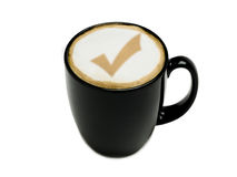 Kaffee mit Prüfzeichen Stockbilder