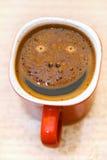 Kaffee mit smileygesicht Stockfotos