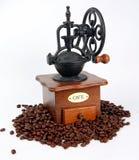 Kaffee-Schleifer mit Kaffeestauräumen Lizenzfreie Stockbilder