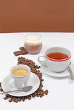 Kaffee-, Tee- und chocosahne Stockfotos