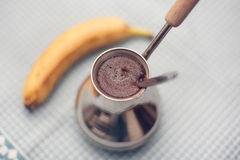 Kaffee und Banane Lizenzfreie Stockfotografie