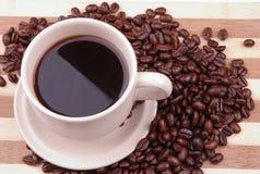 Kaffee und Bohnen Lizenzfreie Stockbilder