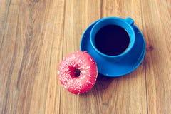 Kaffee und Donut Stockbild