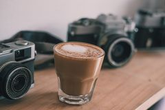 Kaffee und Fotografie lizenzfreies stockbild