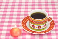 Kaffee und Kerze Stockfoto