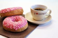 Kaffee und Nachtisch Stockfotografie