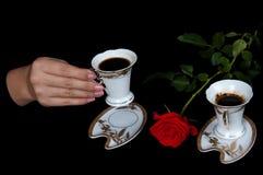 Kaffee und Rot stiegen Stockbilder