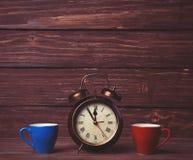 Kaffee und Wecker Lizenzfreie Stockbilder
