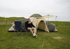 Kaffee und Zelt. Stockfotografie