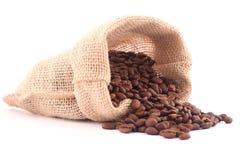 Kaffeebeutel und Lotkörner des Kaffees Lizenzfreie Stockfotos