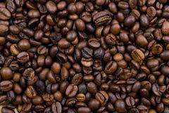 Kaffeebohnehintergrund Stockbilder