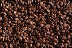 Kaffeebohnehintergrund stockfotos