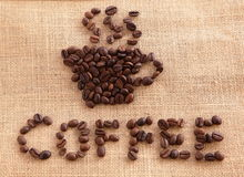 Kaffeebohnen auf Leinenhintergrund Lizenzfreie Stockfotos