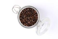 Kaffeebohnen in der Glasgefäßstellung Lizenzfreie Stockbilder