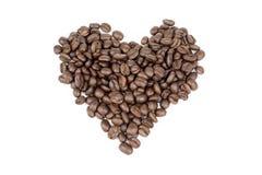 Kaffeebohnen in der Innerform Stockfotos