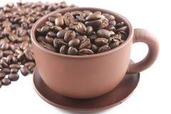 Kaffeebohnen in der Kaffeetasse Lizenzfreies Stockbild