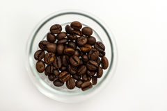 Kaffeebohnen in einem Glas Stockbild