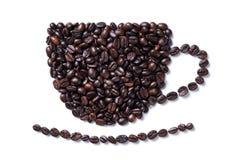 Kaffeebohnen in Form einer Kaffeetasse mit Platte Stockbild