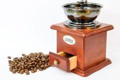 Kaffeebohnen mit altem Schleifer Lizenzfreies Stockbild
