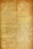 Kaffeefleck auf dem alten faltenden grunge Papier Lizenzfreies Stockbild