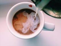 Kaffeeliebesmilch Stockbild