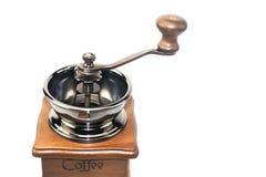 Kaffeemühle auf brauner hölzerner Lagerung Lizenzfreie Stockbilder