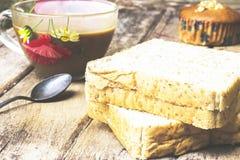 Kaffeepause mit Snack Stockfotografie