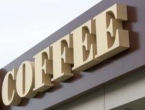 Kaffeeschild mit braunem Hintergrund 2 Stockbild